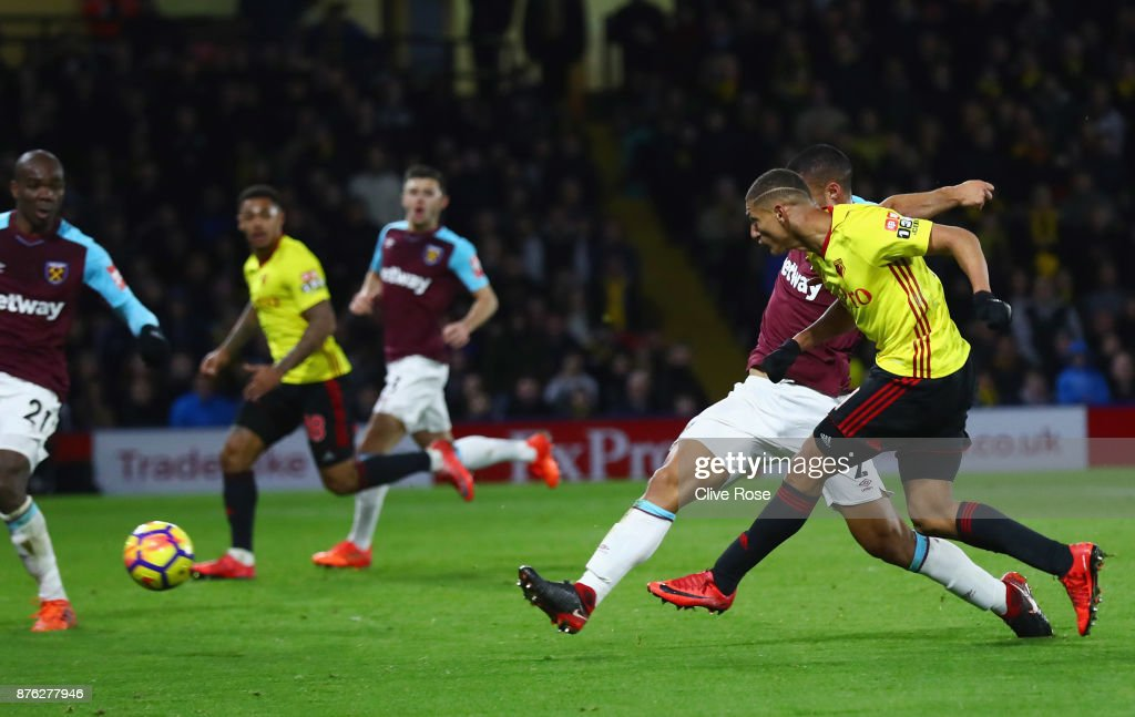 Richarlison de Andrade of Watford (R) scores their second goal during the Premier League match between Watford and West Ham United at Vicarage Road on November 19, 2017 in Watford, England.