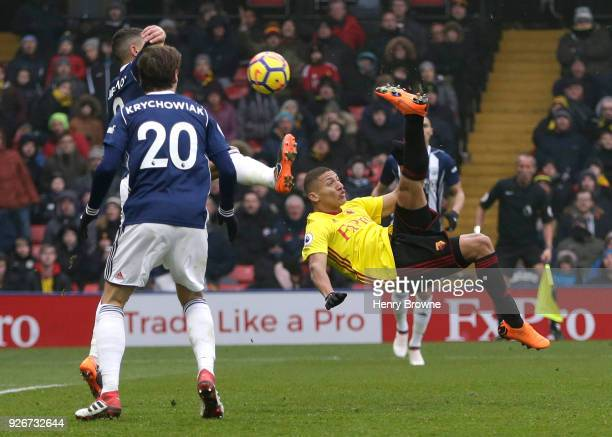 Richarlison de Andrade of Watford takes a shot and misses during the Premier League match between Watford and West Bromwich Albion at Vicarage Road...