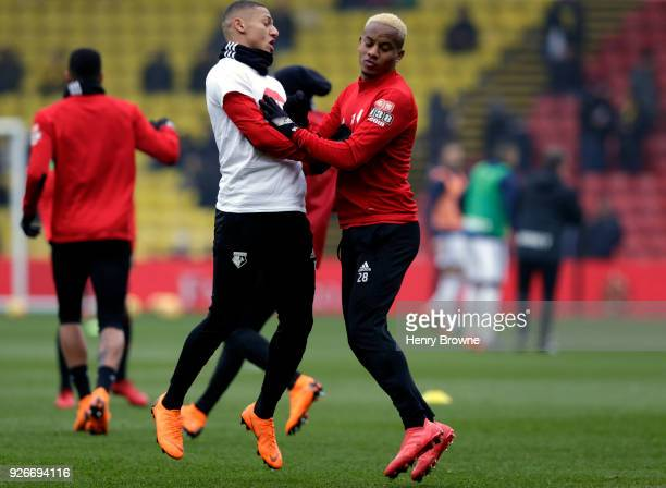 Richarlison de Andrade of Watford warms up with Andre Carrilo of Watford during the Premier League match between Watford and West Bromwich Albion at...