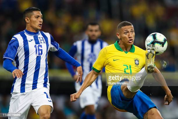 Richarlison of Brazil and Hector Castellanos of Honduras compete for the ball during the International Friendly Match between Brazil and Honduras at...