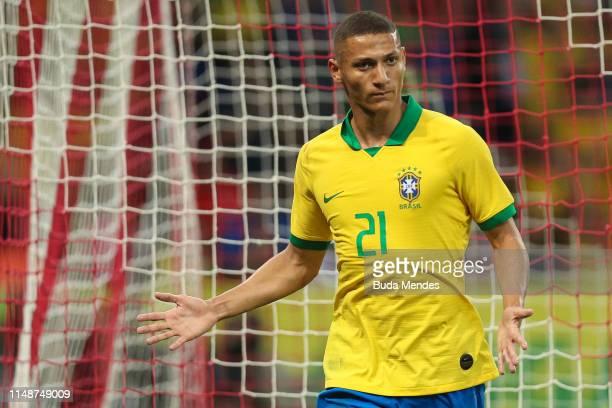 Richarlison of Brazil celebrates a scored goal during the International Friendly Match between Brazil and Honduras at Beira Rio Stadium on June 9...