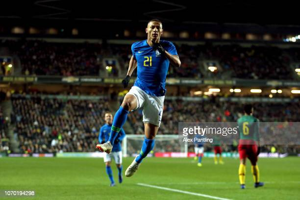 Richarlison of Brazil celebrates after he scores his sides first goal during the International Friendly match between Brazil and Cameroon at Stadium...