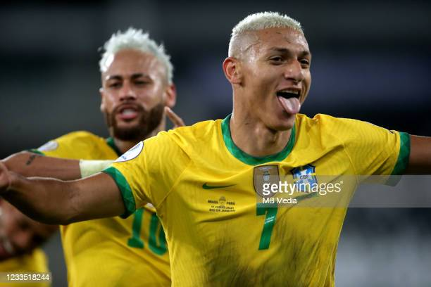 Richarlison of Brazil celebrates after scores his goal with his team mate Neymar during the match between Brazil and Peru as part of Conmebol Copa...