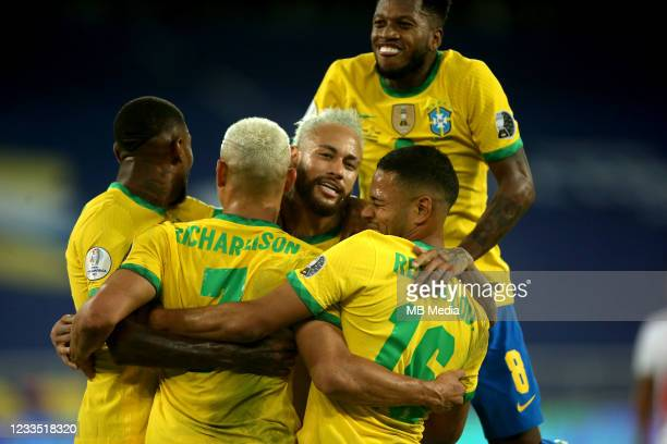 Richarlison of Brazil celebrates after scores his goal with his team mates Neymar, Emerson, Renan Lodi and Fred during the match between Brazil and...