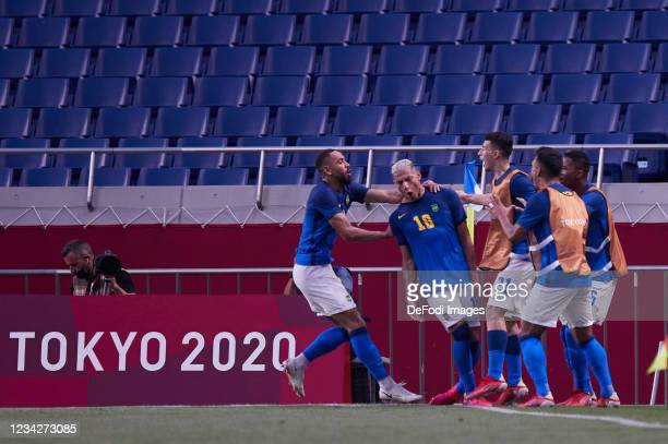 Richarlison of Brazil celebrates after scoring his team's second goal with teammates during the Men's Group D match between Saudi Arabia and Brazil...