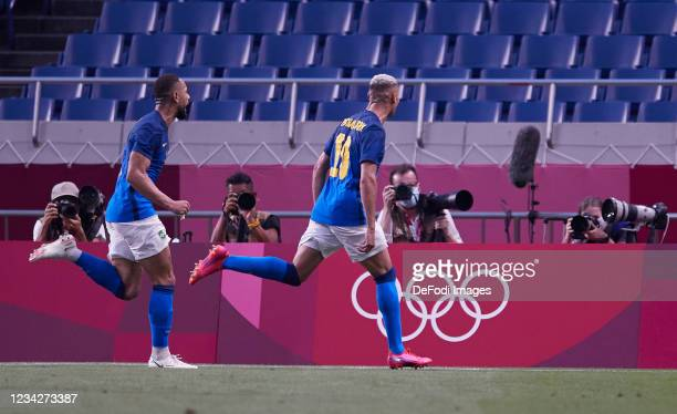 Richarlison of Brazil celebrates after scoring his team's second goal during the Men's Group D match between Saudi Arabia and Brazil on day five of...