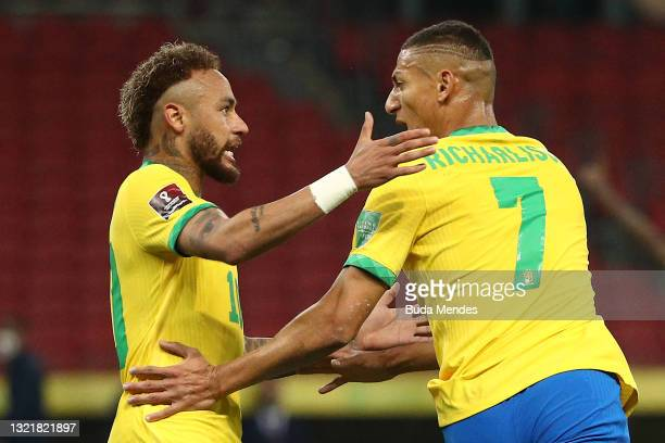 Richarlison of Brazil celebrates after scoring the first goal of his team with Neymar Jr. During a match between Brazil and Ecuador as part of South...