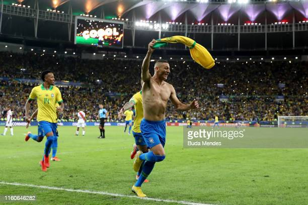 Richarlison of Brazil celebrates after scoring the third goal of his team during the Copa America Brazil 2019 Final match between Brazil and Peru at...