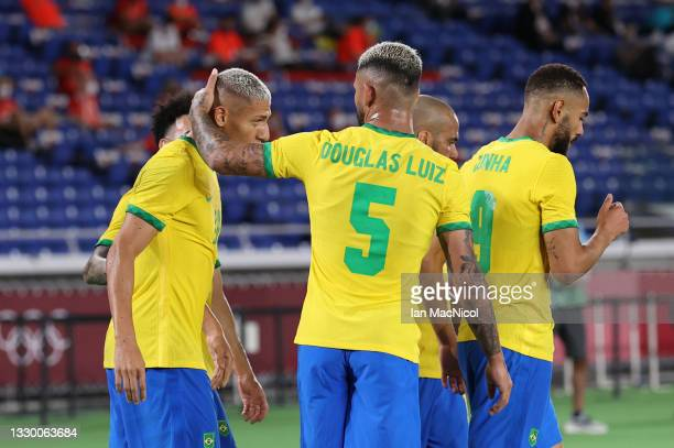 Richarlison of Brazil celebrates with Douglas Luiz after he scores his team's third goal in the Men's First Round Group D match during the Tokyo 2020...