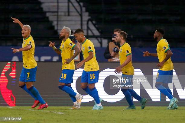 Richarlison of Brazil celebrates with teammates after scoring the fourth goal of his team during a match between Brazil and Peru as part of Group B...