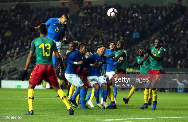 Richarlison of Brazil scores his sides first goal during the International Friendly match between Brazil and Cameroon at Stadium MK on November 20...