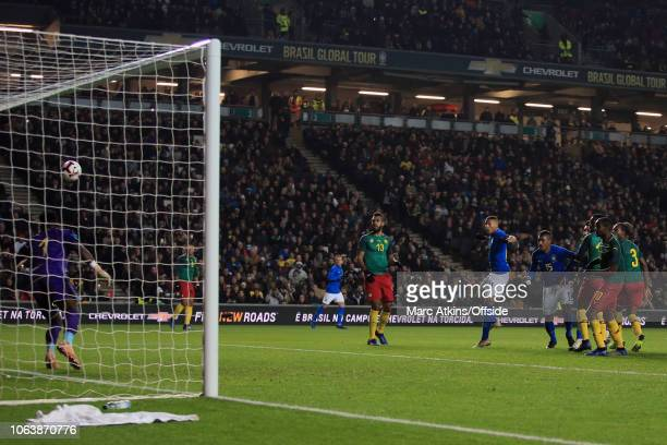 Richarlison of Brazil scores their 1st goal during the International Friendly match between Brazil and Cameroon at Stadium mk on November 20 2018 in...