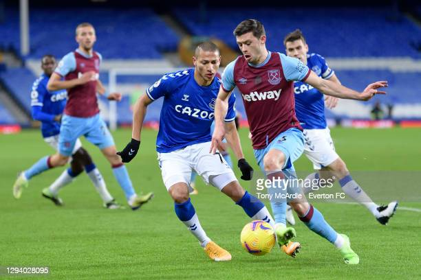 Richarlison of Everton and Aaron Cresswell during the Premier League match between Everton and West Ham United at Goodison Park on January 1 2021 in...