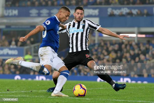 Richarlison of Everton and Fabian Schar challenge for the ball during the Premier League match between Everton and Newcastle United at Goodison Park...