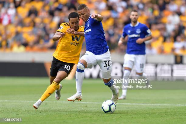 Richarlison of Everton and Helder Costa challenge for the ball during the Premier League match between Wolverhampton Wanderers and Everton FC at...