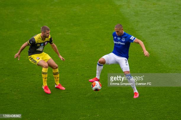 Richarlison of Everton and Jack Stephens of Southampton in action during the Premier League match between Everton FC and Southampton FC at Goodison...