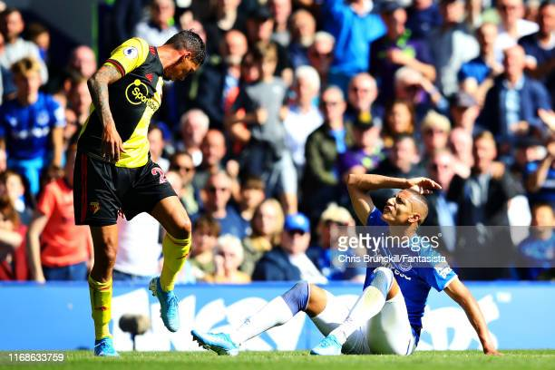 Richarlison of Everton and Jose Holebas of Watford argue after a challenge during the Premier League match between Everton FC and Watford FC at...