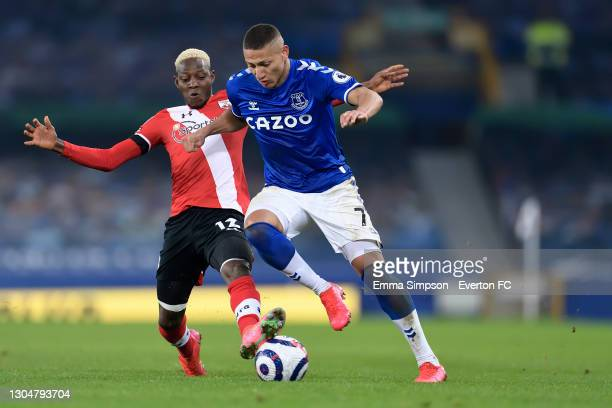 Richarlison of Everton and Lucas Digne challenge for the ball during the Premier League match between Everton and Southampton at Goodison Park on...