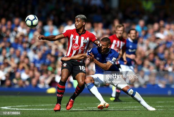 Richarlison of Everton and Mario Lemina of Southampton battle for the ball during the Premier League match between Everton FC and Southampton FC at...
