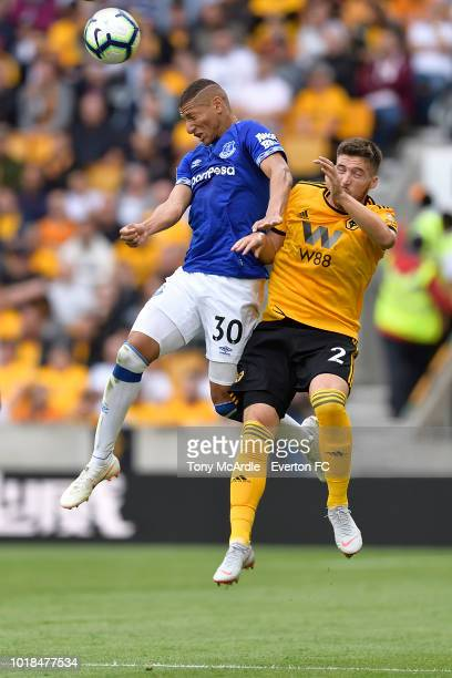 Richarlison of Everton and Matt Doherty challenge for the ball during the Premier League match between Wolverhampton Wanderers and Everton FC at...