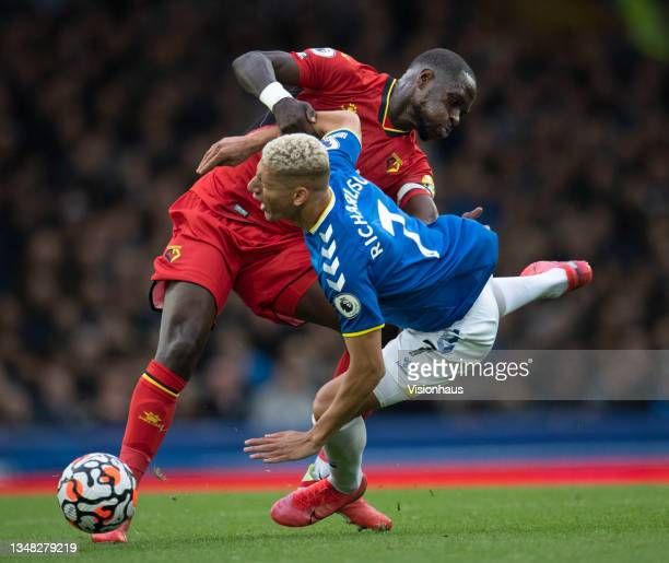 Richarlison of Everton and Moussa Sissoko of Watford in action during the Premier League match between Everton and Watford at Goodison Park on...