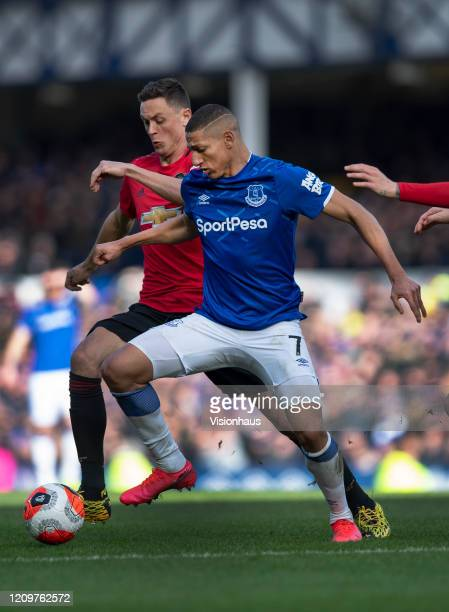 Richarlison of Everton and Nemanja Matic of Manchester United in action during the Premier League match between Everton FC and Manchester United at...