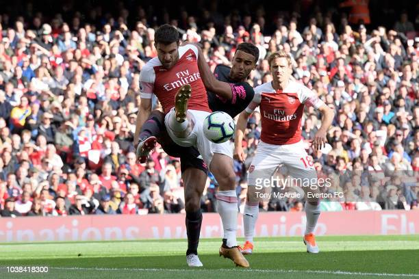 Richarlison of Everton and Sokratis Papastathopoulos challenge for the ball during the Premier League match between Arsenal v Everton at Emirates...