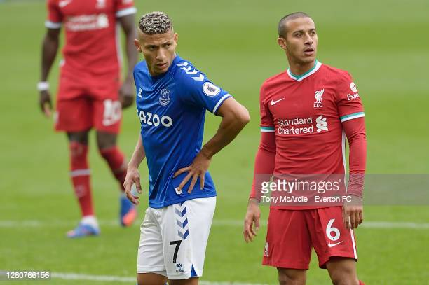 Richarlison of Everton and Thiago Alcantara during the Premier League match between Everton and Liverpool at Goodison Park on October 17 2020 in...