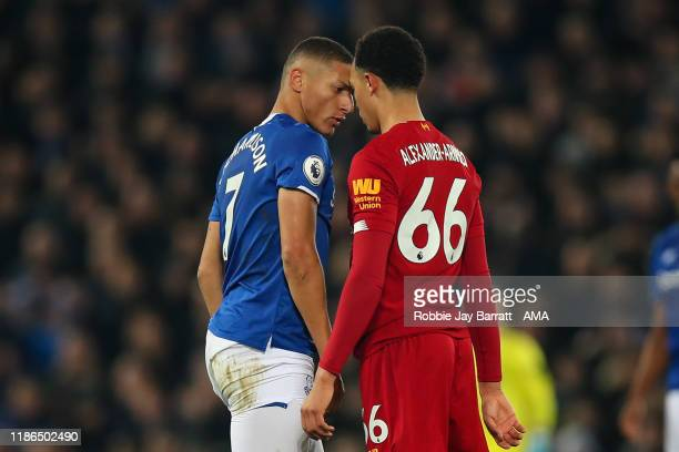 Richarlison of Everton and Trent AlexanderArnold of Liverpool square up to each other during the Premier League match between Liverpool FC and...