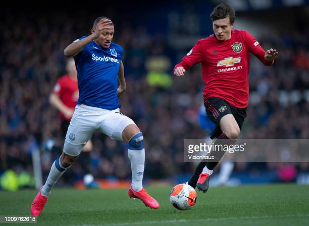 Richarlison of Everton and Victor Lindelof of Manchester United in action during the Premier League match between Everton FC and Manchester United at...