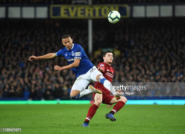 Richarlison of Everton battles with Andy Robertson of Liverpool during the Premier League match between Everton FC and Liverpool FC at Goodison Park...