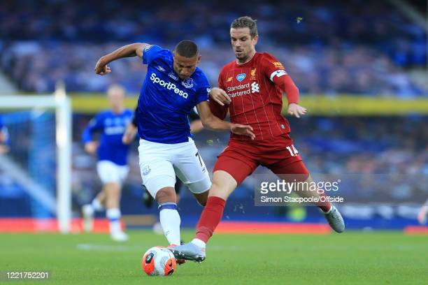 Richarlison of Everton battles with Jordan Henderson of Liverpool during the Premier League match between Everton FC and Liverpool FC at Goodison...