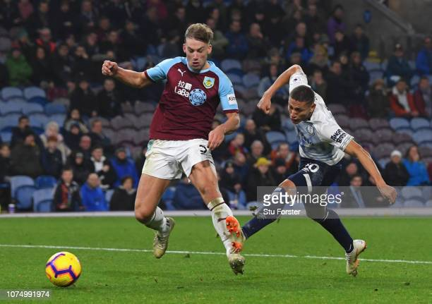 Richarlison of Everton beats Charlie Taylor of Burnley as he scores his team's fifth goal during the Premier League match between Burnley FC and...