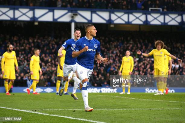 Richarlison of Everton celebrates after scoring his sides first goal during the Premier League match between Everton FC and Chelsea FC at Goodison...