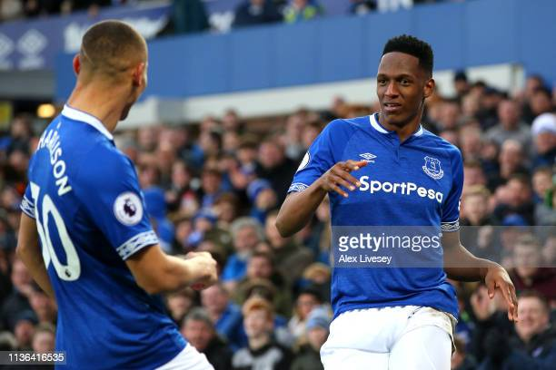 Richarlison of Everton celebrates after scoring his sides first goal with Yerry Mina during the Premier League match between Everton FC and Chelsea...