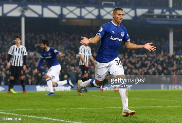 Richarlison of Everton celebrates after scoring his team's first goal during the Premier League match between Everton FC and Newcastle United at...