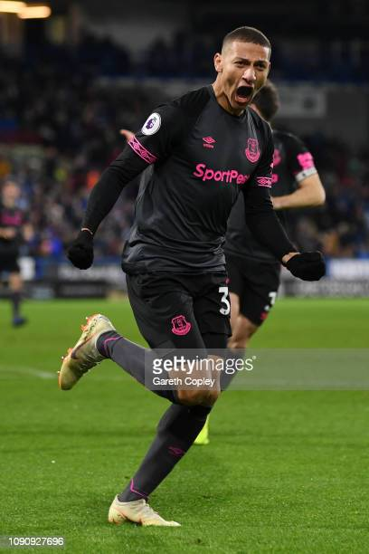 Richarlison of Everton celebrates after scoring his team's first goal during the Premier League match between Huddersfield Town and Everton at John...