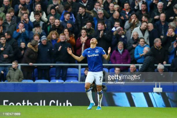 Richarlison of Everton celebrates after scoring his team's first goal during the Premier League match between Everton FC and Chelsea FC at Goodison...