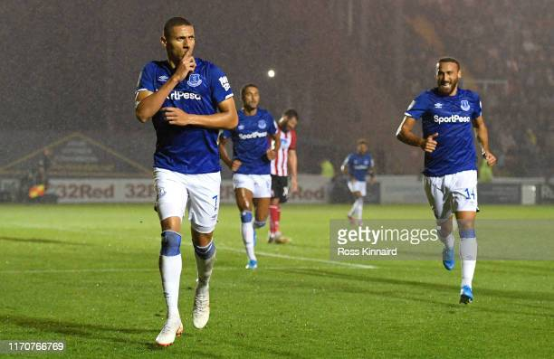 Richarlison of Everton celebrates after scoring his team's fourth goal during the Carabao Cup Second Round match between Lincoln City and Everton at...