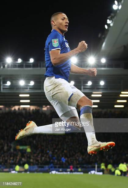 Richarlison of Everton celebrates after scoring his team's second goal during the Carabao Cup Round of 16 match between Everton and Watford at...