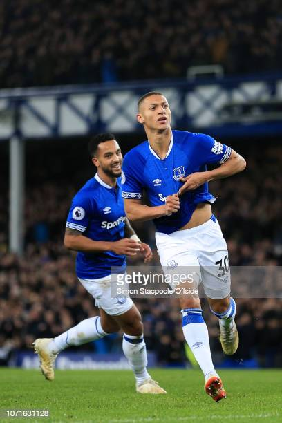 Richarlison of Everton celebrates after scoring their 1st goal during the Premier League match between Everton and Watford at Goodison Park on...