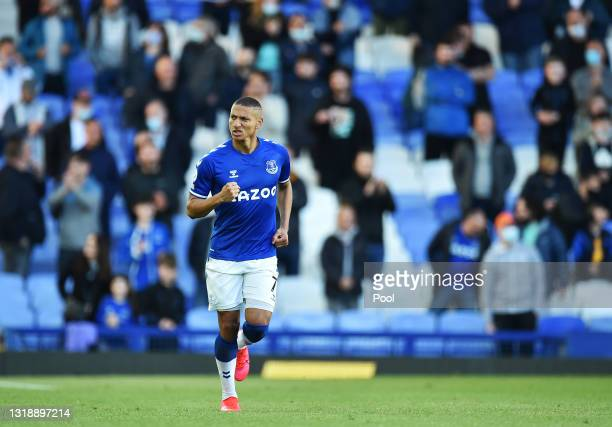Richarlison of Everton celebrates after scoring their sides first goal during the Premier League match between Everton and Wolverhampton Wanderers at...