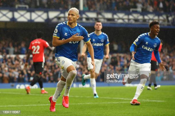 Richarlison of Everton celebrates after scoring their side's first goal during the Premier League match between Everton and Southampton at Goodison...