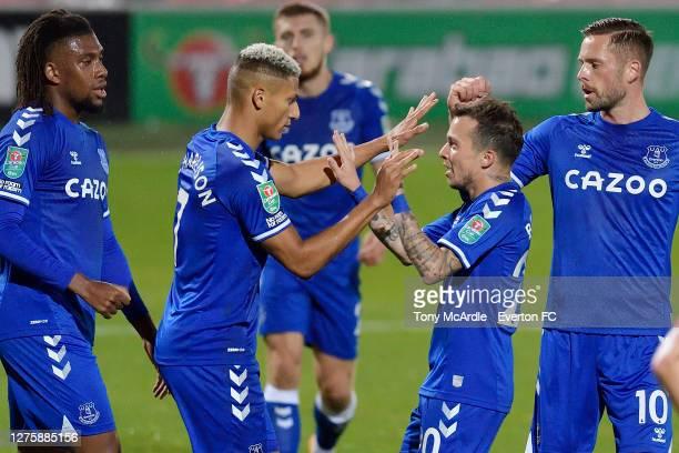 September 23: Richarlison of Everton celebrates his first goal with Bernard Alex Iwobi and Gylfi Sigurdsson during the Carabao Cup Third Round match...