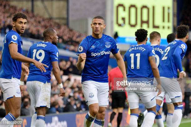 Richarlison of Everton celebrates his goal during the Premier League match between Everton and Chelsea at Goodison Park on December 7 2019 in...