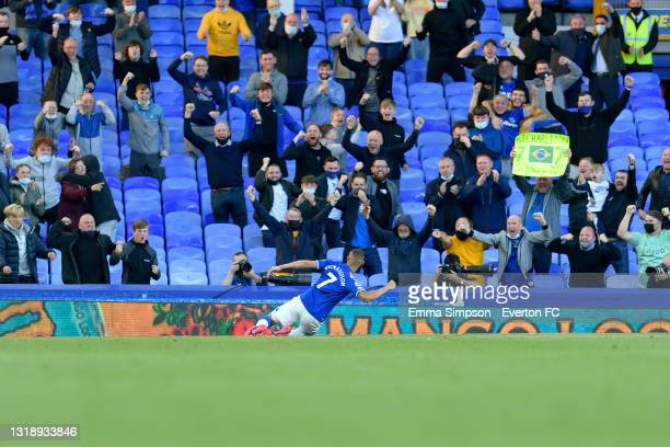 Richarlison of Everton celebrates his goal in front of fans and photographers during the Premier League match between Everton and Wolverhampton...