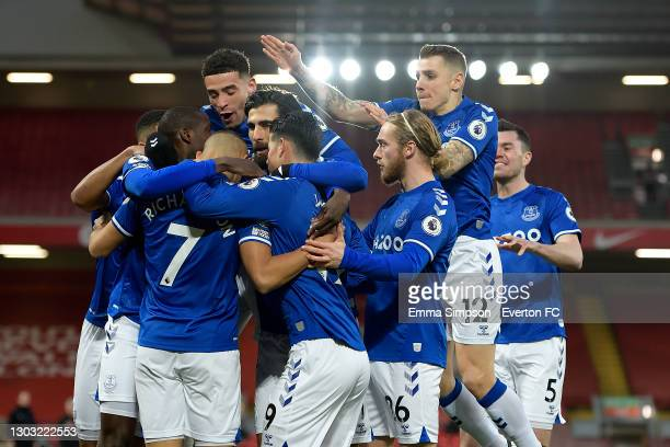 Richarlison of Everton celebrates his goal with Ben Godfrey Andre Gomes Tom Davies Lucas Digne and team mates during the Premier League match between...
