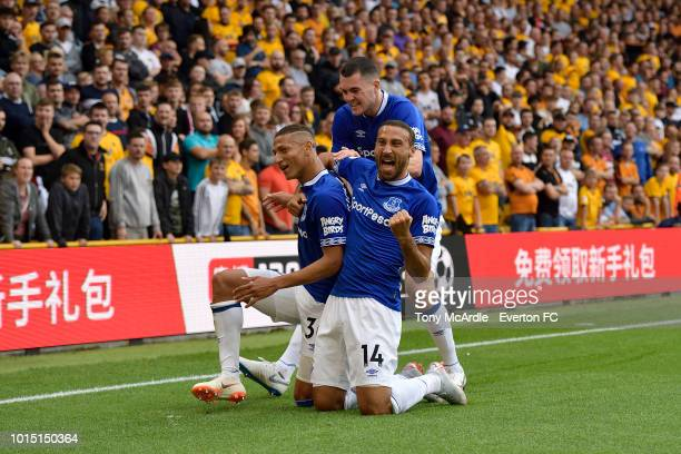 Richarlison of Everton celebrates his goal with Cenk Tosun and Michael Keane during the Premier League match between Wolverhampton Wanderers and...