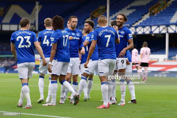 Richarlison of Everton celebrates his goal with Dominic Calvert-Lewin and Gylfi Sigurdsson during the Premier League match Everton and Leicester City...