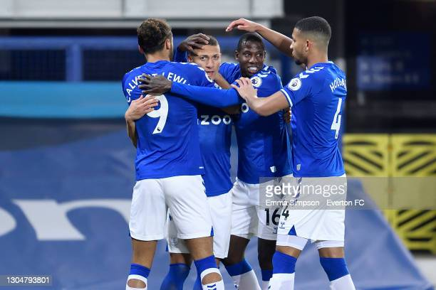 Richarlison of Everton celebrates his goal with Dominic Calvert-Lewin Abdoulaye Doucoure and Mason Holgate during the Premier League match between...
